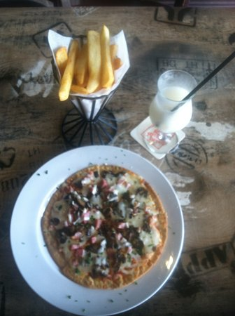 Village Grille: No pizza is ever alone with perfectly fried fries and virgin pina colada