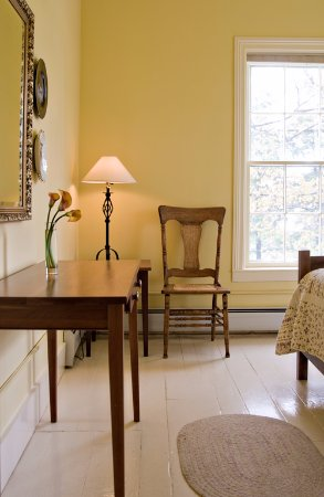The beautiful Middlebury room with its original white painted pine floor.