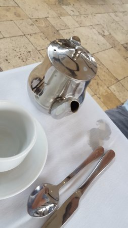 Laugharne, UK: Boiling hot water spilled on our table with no apology