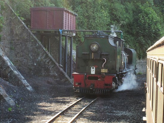 Porthmadog, UK: WHR loco taking on water at Caernarfon
