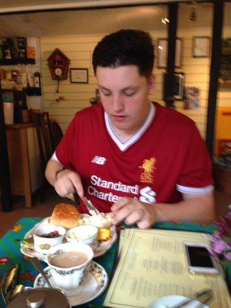 Hartfield, UK: My son getting stuck into the cream tea, already one scone down!