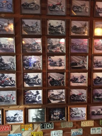 Sandy, OR: Walls are covered with pictures of bikes that visited the bar