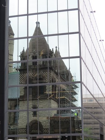 Trinity Church: Church reflecting off office building