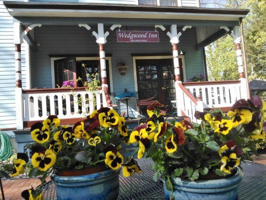 New Hope's 1870 Wedgwood Bed and Breakfast Inn: Back Porch at Wedgewood Inn overlooks tall shade trees and flowering gardens. #WedgwoodInn