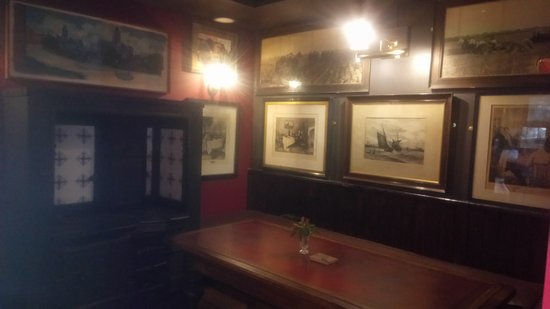 Dalkey, Ireland: Another photo of the snug with the salvaged range cooker and old lighting