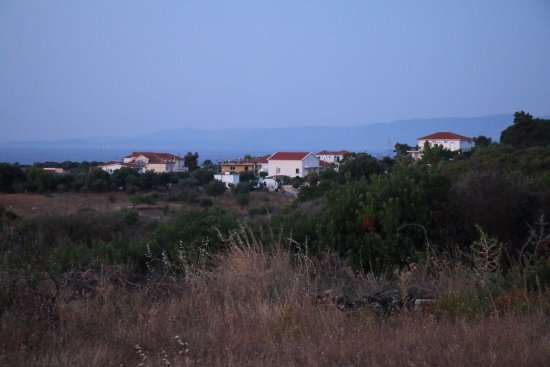 Livadaki Village Hotel: Skala across the field from the hotel