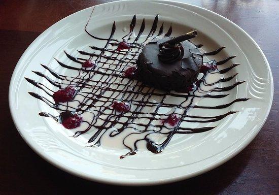 Newburyport, MA: Flourless chocolate cake, drizzled with chocolate and raspberry sauce.