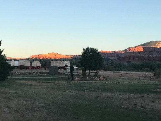 Capitol Reef Resort: View of the covered wagons at sunrise.