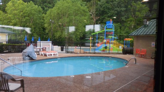 Outdoor pool with slide  Waterpark outdoor pool and smaller slide play area - Picture of ...