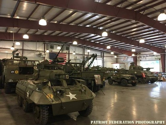 Old Bethpage, NY: Tanks are behind these vehicles