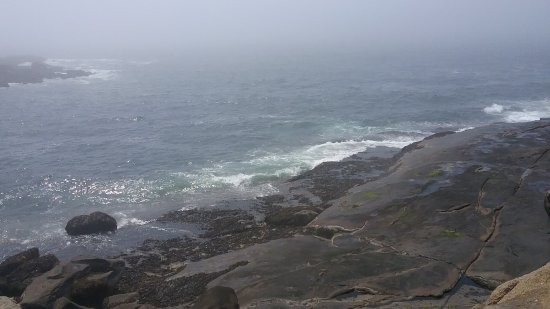 York, ME: The lighthouse and the rocks in a mid-morning mist.  The photos do not do justice to the look an
