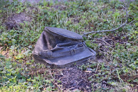 Corinth, MS: Kepi hat on path leading to facility entrance
