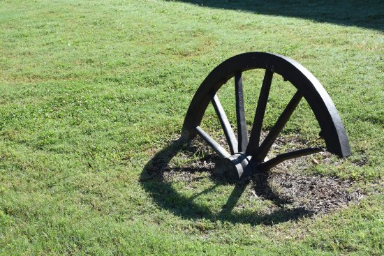 Corinth, MS: Broken wagon/cannon wheel on path leading to facility entrance