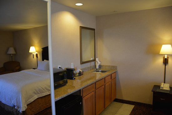 Gallup, NM: Bedroom wall bed shown in mirror