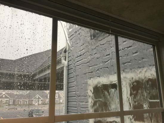 Baldwinsville, NY: water poring in through window seal during rainstorm