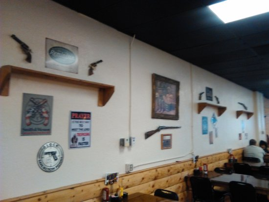 What else would you expect on the walls of a restaruant named Shooters in Rifle, CO?