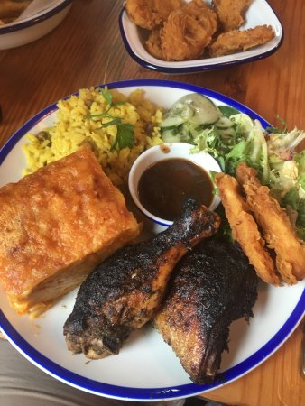 Brighton and Hove, UK: Jerk Chicken, Mac pie, rice and peas, plantain and salad with jerk sauce.