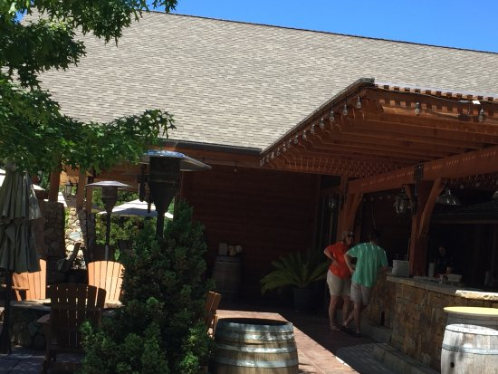 Grants Pass, OR: The outdoor patio at Schmidt Family Vineyard is a perfect setting for tasting wine.