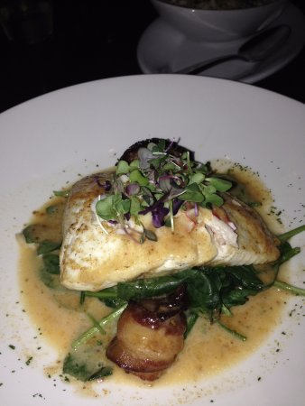 The Woodlands, TX: Halibut - 2 bacon wrapped sea scallops, sauteed spinach in lemon butter.