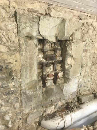 Pevensey, UK: A Tudor window complete with Iron Grill from original Gaol was recently found under d mortar whe