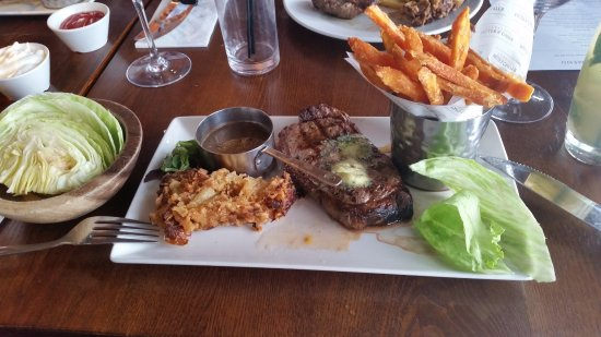 Abridge, UK: grain fed sirloin cooked medium rare with sweet potato fries