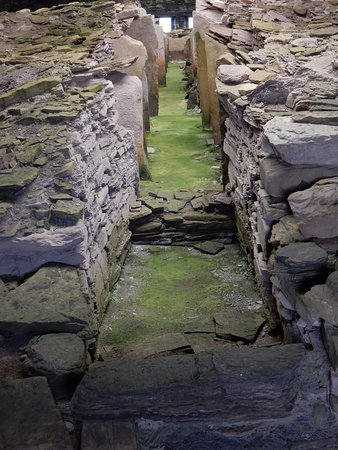 Rousay, UK: This photograph does not reveal the full extent of Midhowe Chambered cairn.