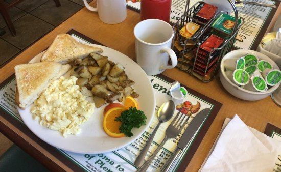 Horn of Plenty Cafe: My lady's scrambled eggs and hash browns.