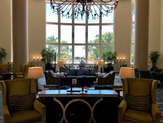 The Ritz-Carlton Key Biscayne, Miami: Tasteful, grand, and comfortable lobby with a magnificent view of the grounds and beachfront