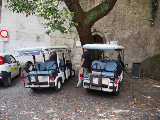Rudy's Touring Service - Driving & Walking Tours: The golf carts outside the Rome Wall.