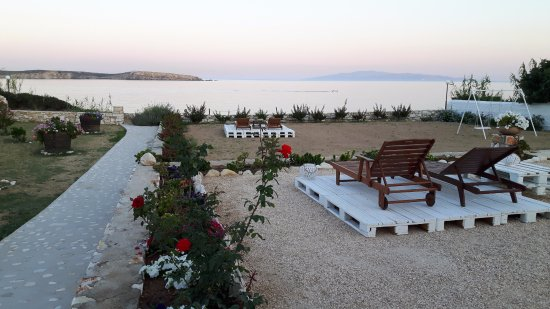 Ilios of Paros: A relaxing area of our garden, overlooking the blue of the sea