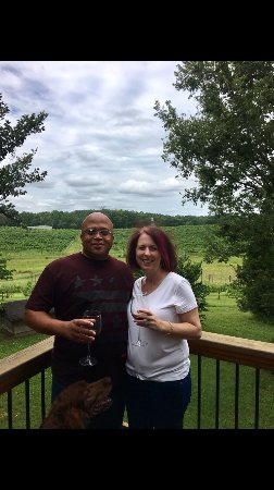 Columbus, NC: Enjoying our anniversary from the deck at the tasting room. Chapel steeple in the background.