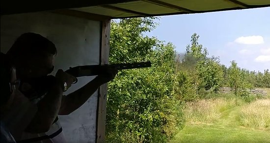 Warrington, UK: A friend mid-shot as he aims for the clays.