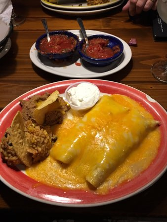 Grandville, MI: Chicken Enchilada, rice, beans with salsa in the back.