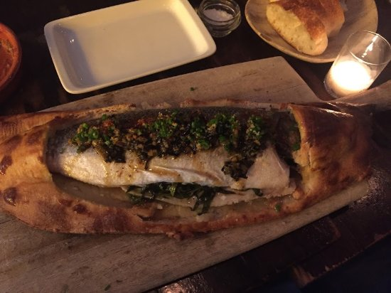 ‪‪Toro‬: Whole roasted Mediterranean bass with salt crust and charred allium‬