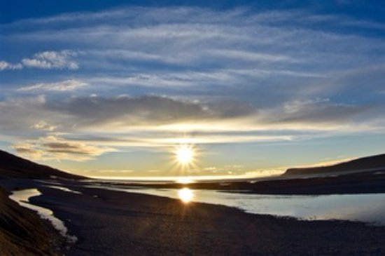 Nunavut, Canada: View from hotel of midnight sun over Cunningham Inlet