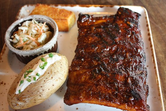 Roadhouse Barbecue: BBQ pork Ribs w/cole slaw & Baked Potato