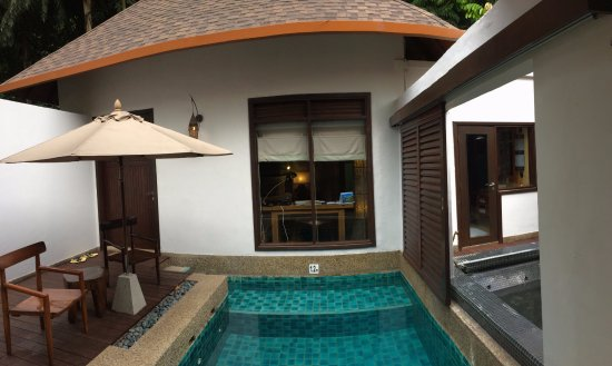 The Banjaran Hotsprings Retreat: The water villa viewed from living room, towards bedroom, pool and hot spring pool (right)