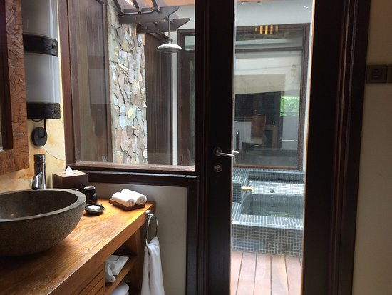 The Banjaran Hotsprings Retreat: Bathroom sink area with walk-in wardrobe looking to hot spring pool