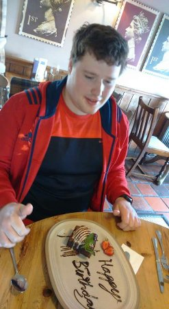Cramlington, UK: R with his birthday dessert