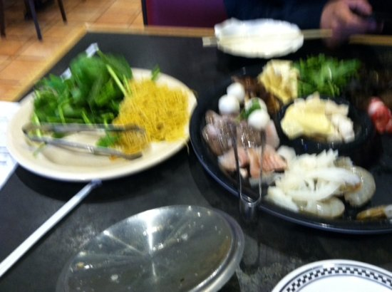 Gaithersburg, MD: Food presentation.  You have to cook the food in individual small hot pots over a small fire.