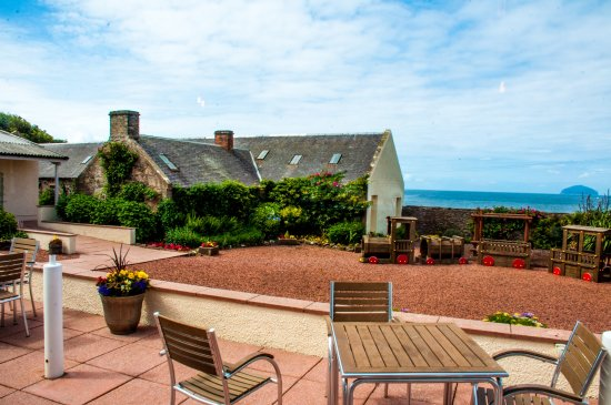 Girvan, UK: View of the garden , terrace and Ailsa Craig from the cafe