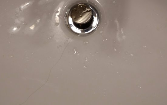 Wingate by Wyndham State Arena Raleigh/Cary: Sink w/ hair & Toothpaste - 2 days old.