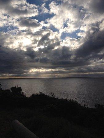 Bermagui, ออสเตรเลีย: Sunrise just 1 min walk to the cliff from Caravan Park