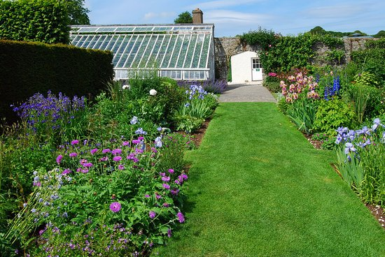 Glenarm, UK: Herbaceous border and the greenhouse.