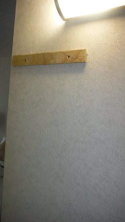 Best Western Plus Milton: why is this piece of wood nailed to the wall?
