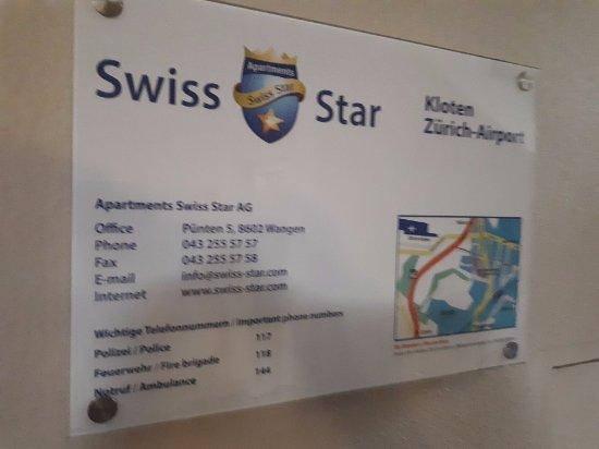 Kloten, Swiss: Контактная информация на стене в холе