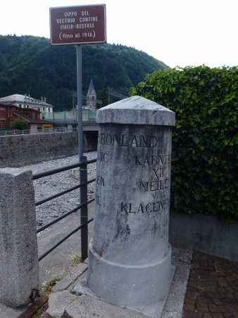 Border marker at the old bridge in Pontebba center