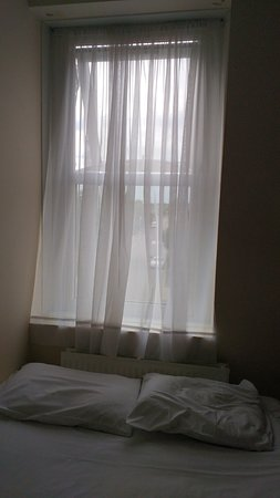 York Hotel: Net curtain in room - can clearly see road outside, and anyone on that road could see in at nigh
