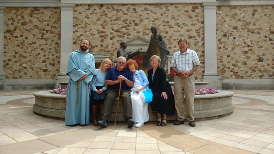 Shrine of Our Lady of Guadalupe: Pilgrim Family with Franciscan Friar.
