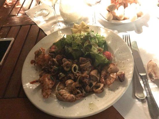 La Tavolozza: Calamari e scampi arrosti and Bistecca Venezzia. Really delicious.